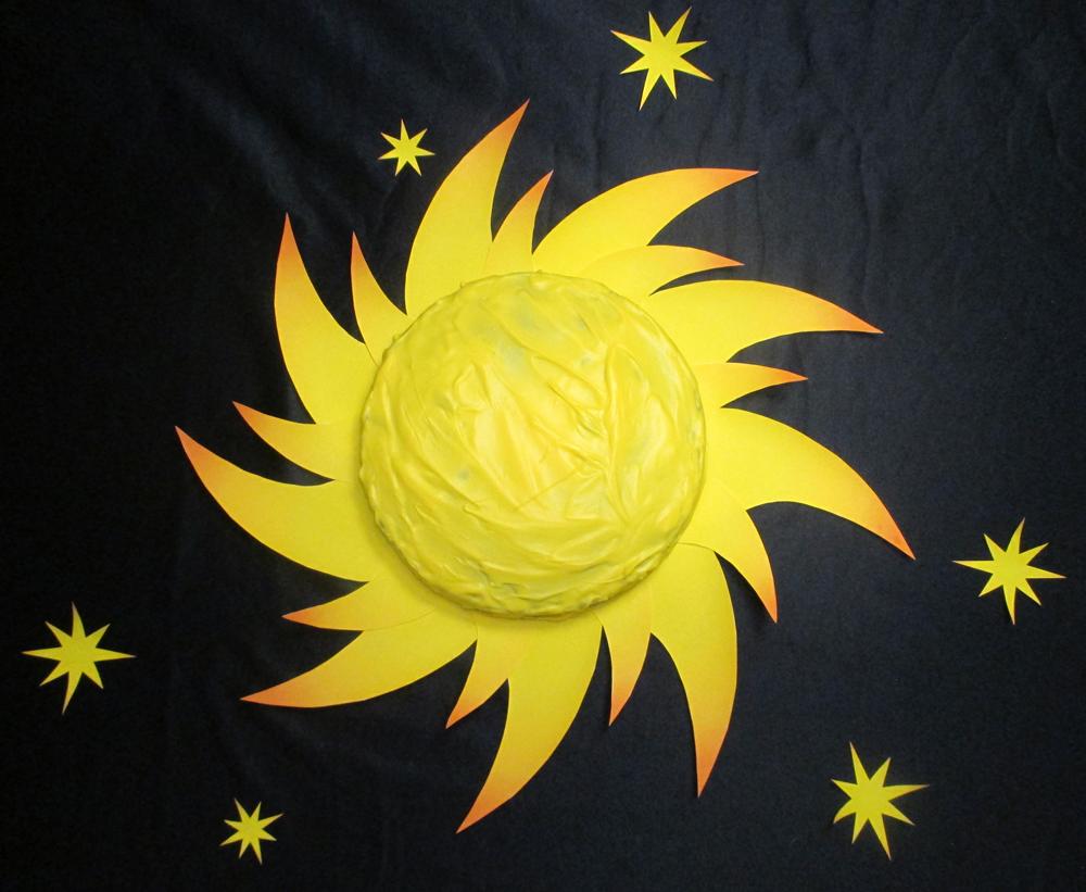 Solkage med solstråler og stjerner